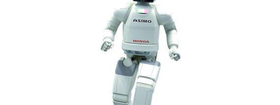 2000: Honda präsentiert das Robotermodell Asimo. Er kann in jeder Hand Gegenstände mit einem Gewicht von 500 Gramm tragen, kann auf unebenen Flächen und auf Flächen mit Steigungen gehen. Zudem versteht er bis zu 50 Sprachbefehle. Foto: Honda